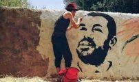 رسم صورة للزفزافي على حائط يقود مواطنا بطاطا للاعتقال (صورة)